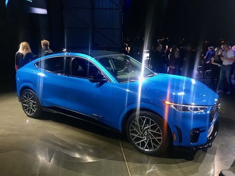 Land vehicle, Vehicle, Car, Auto show, Automotive design, Mid-size car, Electric blue, Sports car, Luxury vehicle, Sedan,