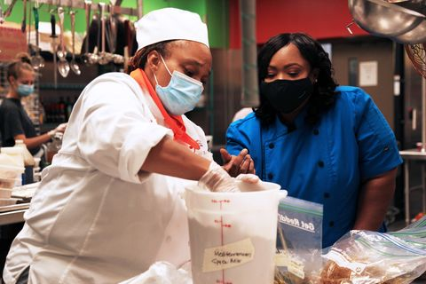 chef moe jordan leads one of her foodworks students