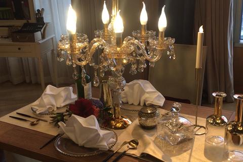 Centrepiece, Restaurant, Stemware, Room, Lighting, Wine glass, Table, Dining room, Interior design, Tableware,