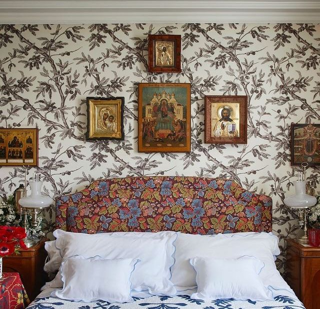 a bedroom decorated with religious icons, as seen in the book decors barbares the echanting interiors of nathalie farman farma