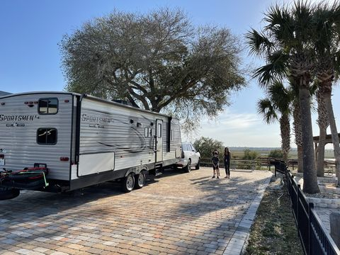 escalade towing travel trailer parked at rv resort
