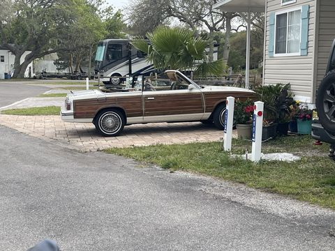woody lebaron parked outside a mobile home