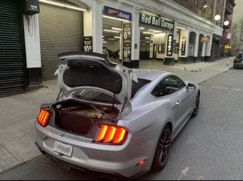 fred ashmore's cannonball record breaking mustang outside the red ball garage in new york city