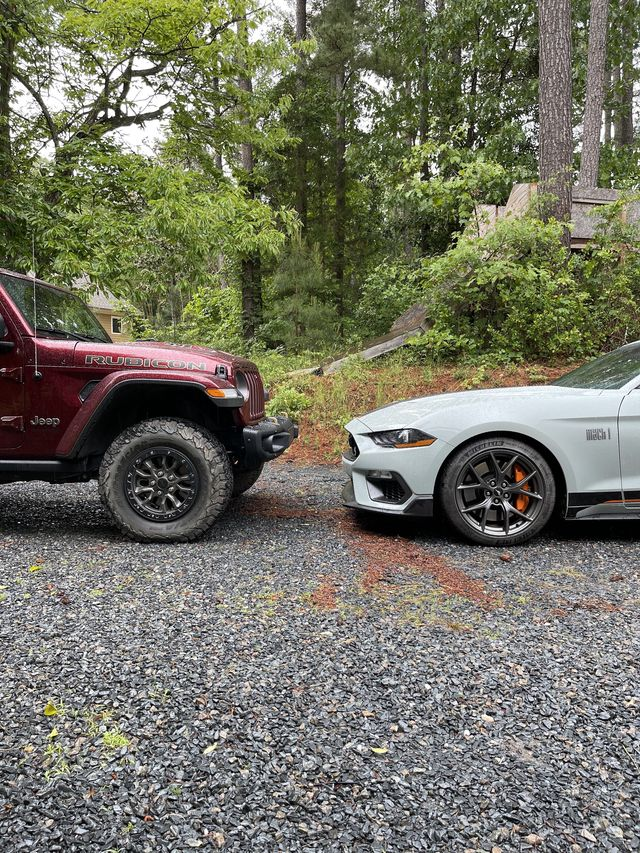 ford mustang mach 1 facing jeep wrangler 392