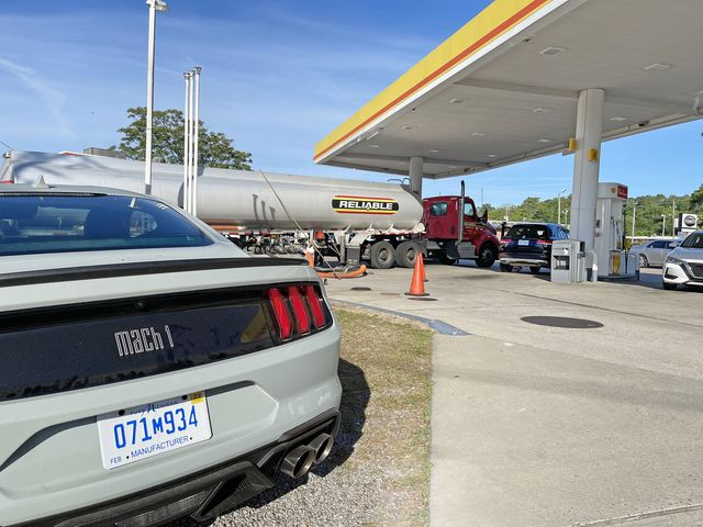 mustang mach1 at a gas station