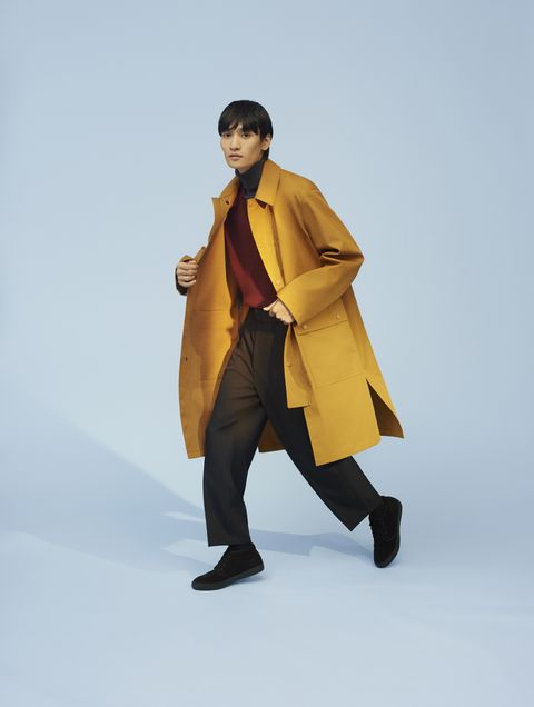 Clothing, Yellow, Standing, Outerwear, Overcoat, Fashion, Coat, Footwear, Trench coat, Fashion model,