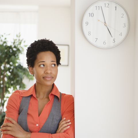 impatient african american businesswoman leaning against wall