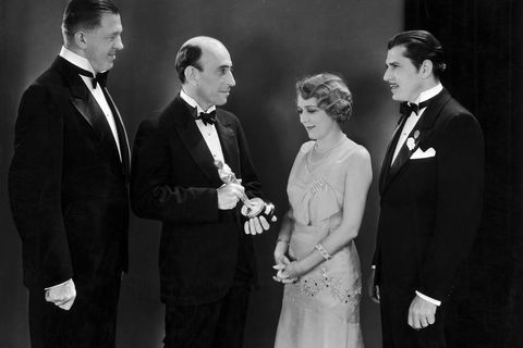 Mary Pickford, Warner Baxter And Hans Kraly Receiving An Oscar 1929