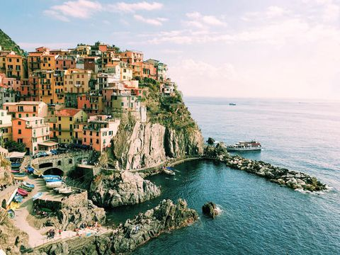 Body of water, Coast, Sea, Cliff, Promontory, Coastal and oceanic landforms, Natural landscape, Town, Rock, Azure,