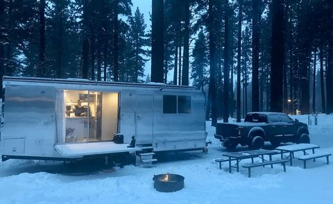 living vehicle camping trailer in snow