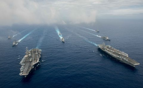 The aircraft carriers USS Reagan, USS Stennis and escorts in the Philippine Sea, 2016.