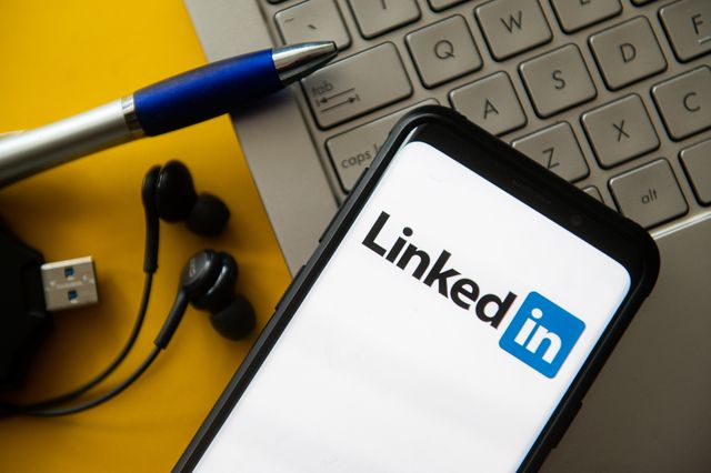 in this photo illustration a linkedin logo seen displayed on
