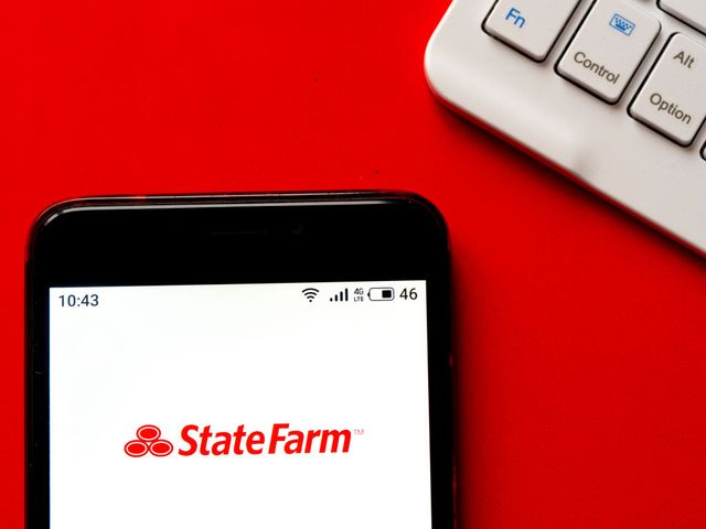 in this photo illustration a state farm logo seen displayed