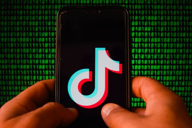 in this photo illustration a tiktok logo is seen displayed