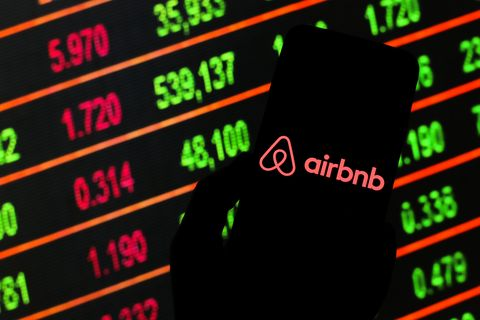 in this photo illustration an airbnb logo seen displayed on