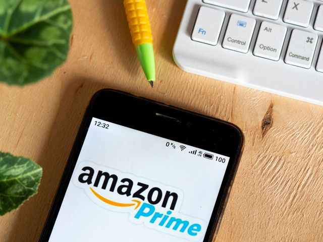 in this photo illustration an amazon prime logo is seen