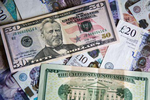 In this photo illustration, British Pound and US Dollars...
