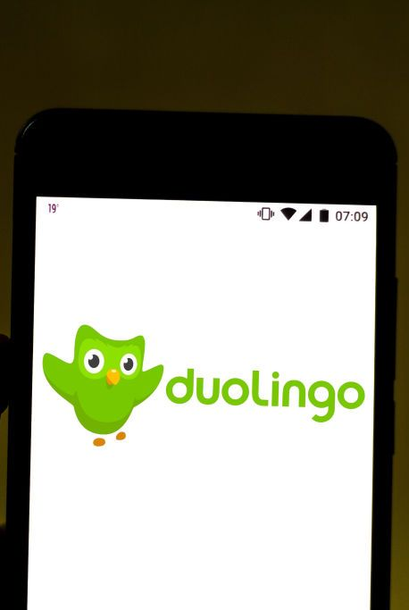 in this photo illustration the duolingo logo is displayed on