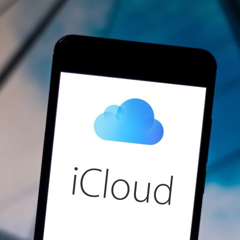 In this photo illustration the iCloud logo is displayed on a...