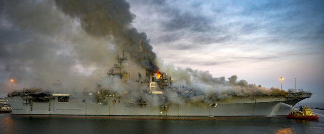 navy ship uss bonhomme richard burns at naval base in san diego