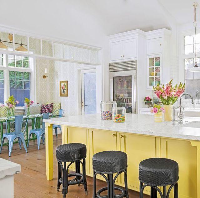 white kitchen with yellow island