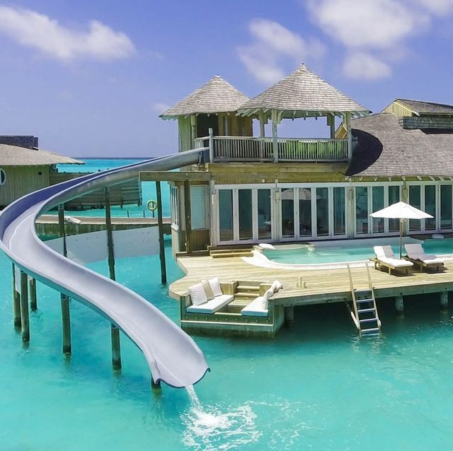 Property, Swimming pool, Resort, Building, House, Vacation, Real estate, Leisure, Home, Sunlounger,