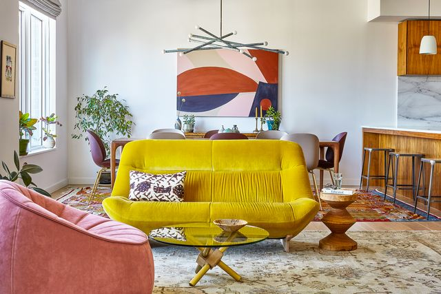 great room with abstract wall art and yellow sofa