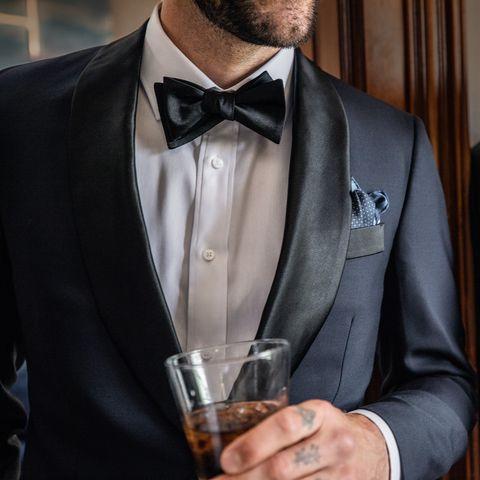 Suit, Formal wear, Tuxedo, Clothing, Tie, White-collar worker, Outerwear, Blazer, Fashion accessory, Businessperson,
