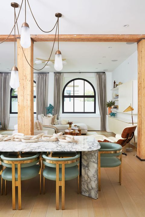 white dining room with marble table