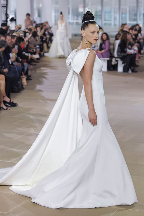 Gown, Wedding dress, Fashion model, Dress, Clothing, Shoulder, Bridal clothing, Bride, Haute couture, Fashion,