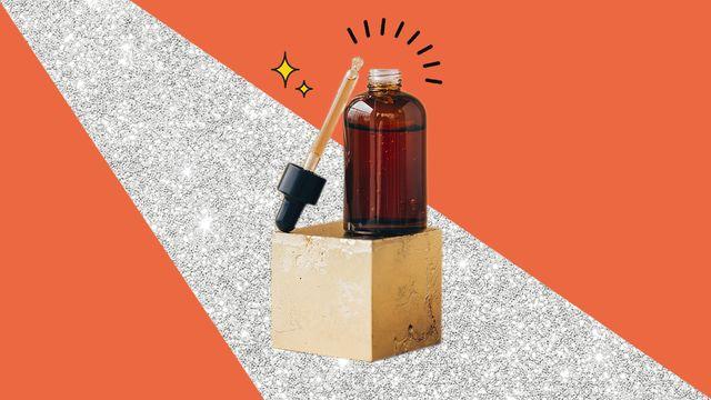 frasco con producto cosmético sobre un pedestal