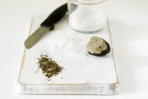 ingredients for preparation of truffle salt, truffle and salt on a white background rustic style