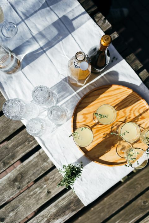 Table, Yellow, Glass, Stemware, Wood, Furniture, Textile, Tableware, Wine glass, Linens,