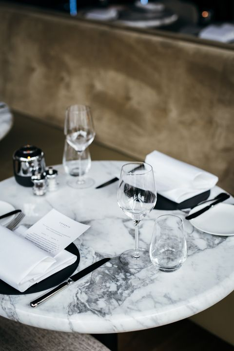 Table, Restaurant, Rehearsal dinner, Black-and-white, Tablecloth, Textile, Tableware, Photography, Glass, À la carte food,