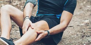 Injured athlete sitting on the ground