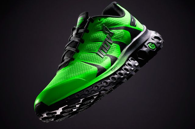 a green and black running shoe