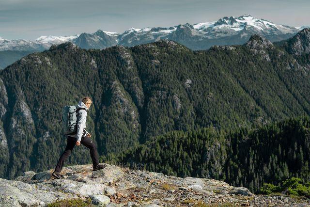 man hiking in mountains wearing arc'teryx gear