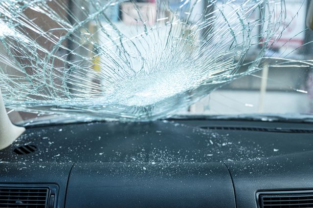 inside of broken car windshield in car accident