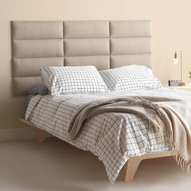 tan modular headboard and grid bedding