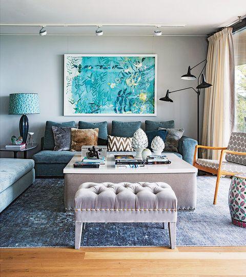 Salón decorado en azul por Laura Gärna