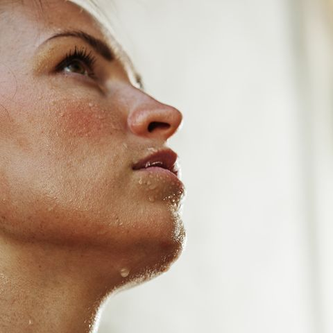 Intense young woman sweating after working out