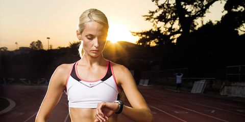 Runner checking pace on GPS watch with 300x150