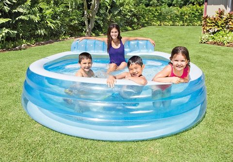 4 kids in an inflatable intex family swim center pool