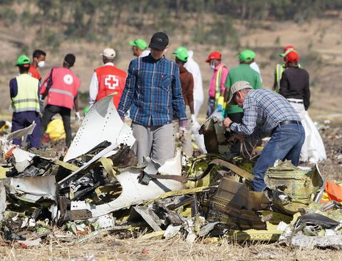 Emergency Services Work At The Crash Site Near Bishoftu Of Ethiopian Airlines ET302 To Nairobi