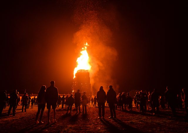 people watch a large bonfire during the eleventh night marking the start of the unionist twelfth celebrations, in craigy hill, larnetonight, large bonfires are lit in many protestant loyalist neighbourhoods of northern irelandbonfires were originally lit to celebrate the glorious revolution 1688 and victory of protestant king william of orange over catholic king james ii at the battle of the boyne 1690, which began the protestant ascendancy in ireland on monday, 12 july 2021, in larne, county antrim, northern ireland photo by artur widaknurphoto