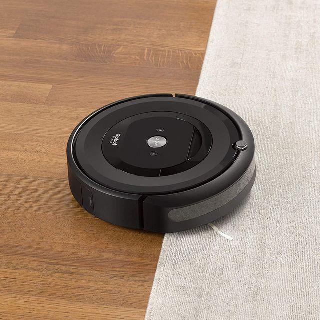 irobot roomba e5 5150 robot vacuum on wood floor and carpet