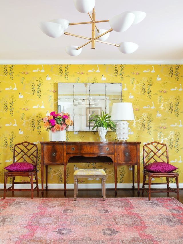 console and chairs in front of chinoiserie wallpaper