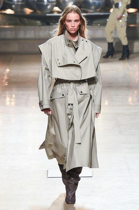 Fashion show, Fashion model, Fashion, Clothing, Runway, Coat, Shoulder, Outerwear, Trench coat, Overcoat,