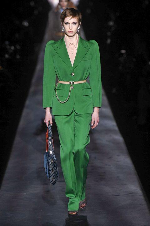 Fashion model, Runway, Fashion, Fashion show, Clothing, Green, Pantsuit, Human, Outerwear, Haute couture,
