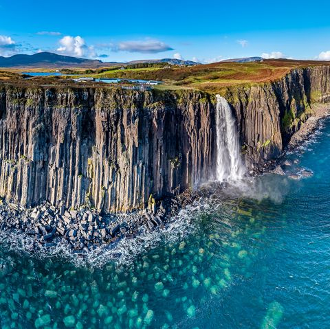 aerial view of the dramatic coastline at the cliffs by staffin with the famous kilt rock waterfall   isle of skye   scotland